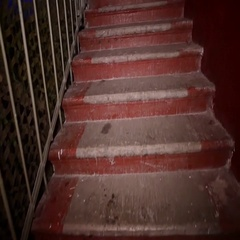 Girl in white dirty bikini go down stairs at Halloween party. Sl Stock Footage