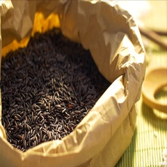 Woman hands are taking some of black rice from a paper food bag. Close up shot. Stock Footage
