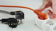 Unplugging and Plugging Orange Cable Stock Footage