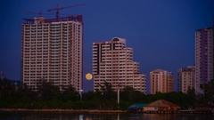 4K Time lapse of super moon rise up with tower foreground Stock Footage