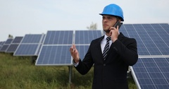 Young Businessperson Communication Talking Cellphone Report About Solar Panels Stock Footage