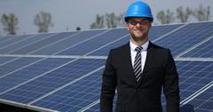 Businessman Portrait Looking Camera Ok Sign Solar Panels Energy Farm Electricity Stock Footage
