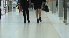 Slow motion of steps,  two girls  go to the Mall after shopping with bags Stock Footage