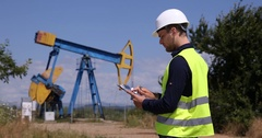 Oil Pump Worker Man Using Calculator Young Petrochemical Production Technician Stock Footage