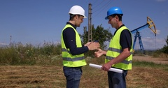 Petroleum Installation Employee Manager and Worker Man Discussing Oil Pump Visit Stock Footage