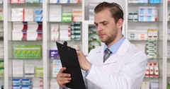 Young Pharmacist Specialist American Writing on Clipboard in Pharmaceutical Shop Stock Footage