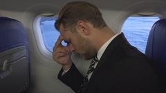 Handsome Businessman Looking Sad Unhappy Frustration Problem Inside Plane Travel Stock Footage