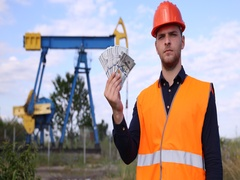 American Pumping Unit Worker Man Showing Money US Dollar Bills Looking Camera Stock Footage