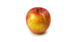 Organic Fuji Apple on white background rotating 360 degrees, loopable Stock Footage