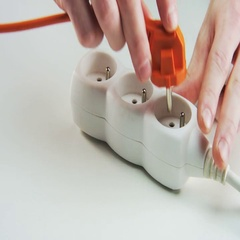 Plugging Orange and Black Cables to a Power Board Stock Footage