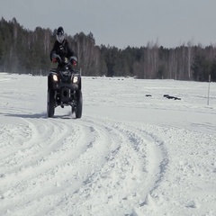 Drift quad on snow Stock Footage