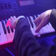 Close-up of a man plays synthesizer on keys Stock Footage