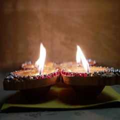 Religious prayer and burning diyas and marigold flower Stock Footage