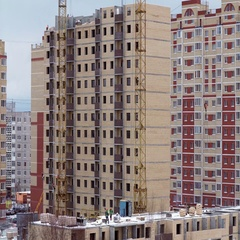Construction site with workers of high-rise houses of brick, 4K time lapse Stock Footage