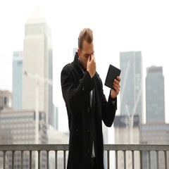 Sad Business Man Using Digital Tablet Bad News Brexit Report London Skyline Day Stock Footage