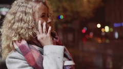 Cute blonde curly girl talks by the phone and holding a cup of coffee, missing Stock Footage