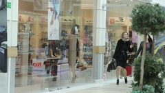 Beautiful business lady walk around the Mall after shopping. Stock Footage