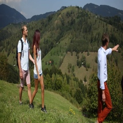 Young Couple Excursionists Walking Touristic Path Looking at Beautiful Mountains Stock Footage