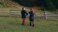 Two little beautiful girls whirl in nature, holding hands Stock Footage