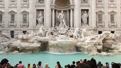 Tourists pose for photos at trevi fountain in rome Stock Footage