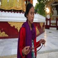 Burmese woman praying near the Shwedagon Pagoda, Yangon, Myanmar. Burma Stock Footage