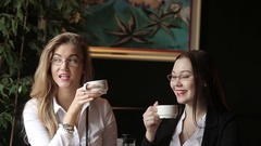 The two girls smile and attract the attention of passers-by. Stock Footage