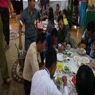 People eat meal in dining room at Shwedagon Pagoda, Yangon, Myanmar. Burma Stock Footage