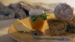A composition of muffins, a jar of jam and a pear. Healthy homemade breakfast. Stock Footage