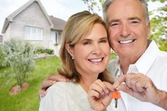 Senior couple with house key. Stock Photos