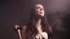 Scary vampire girl with a knife looking angry and have a sinister look. 4K UHD Stock Footage
