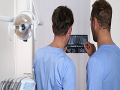 Dentist Men Teamwork Looking Radiography Checking Diagnostic Dental Center Room Stock Footage