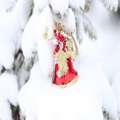 Christmas decorations in a snowy tree Stock Footage