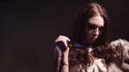 Scary vampire girl with a knife and doggy toy looking angry and have a sinister Stock Footage