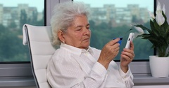 Wrinkled Mother Old Woman Touching Screen Using App Credit Card Shopping Online Stock Footage