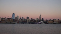The Super Moon rising behind the Empire State Building​ at Sunset Stock Footage