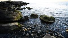 Sea boulders in beach Stock Footage