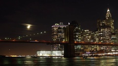 Time-Lapse of the Crescent Moon Seting by the Brooklyn Bridge and Manhattan Stock Footage