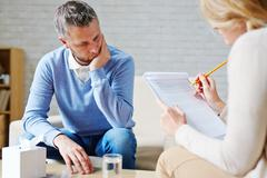 Listening to counselor advice Stock Photos