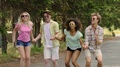 Girls and guys holding hands and jumping at outdoor party, celebrating life HD Footage