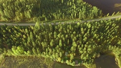 Aerial shot of a white van driving on a scenic small highway in Finnish Stock Footage