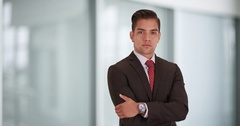 Happy smiling  Hispanic businessman standing in office with arms crossed Stock Footage