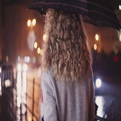 Curly cute girl under umbrella walking down the street in heavy rain, than turns Stock Footage