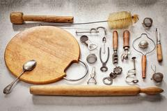 Old pieces of kitchen utensils on a table Stock Photos