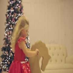 Little girl riding a toy in the New Year's Eve Stock Footage