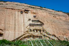 Mati Si cave temple with colorful praying buddhist flags, Zhangye, Gansu provinc Stock Photos