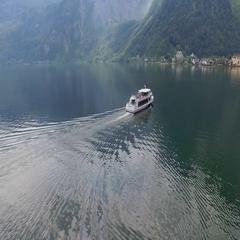 Hallstatt, boat on lake aerial Stock Footage