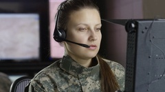 Female miltary drone operator on computer Stock Footage
