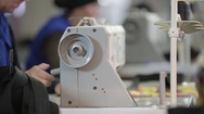 Seamstress working with sewing machine Stock Footage
