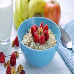 Healthy breakfast - oatmeal with fresh, ripe raspberries and walnuts in a bowl Stock Footage