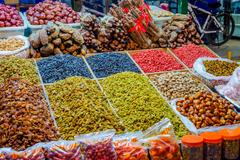Raisins and dry fruits for sale at night market in Dunhuang, Gansu province, Chi Stock Photos